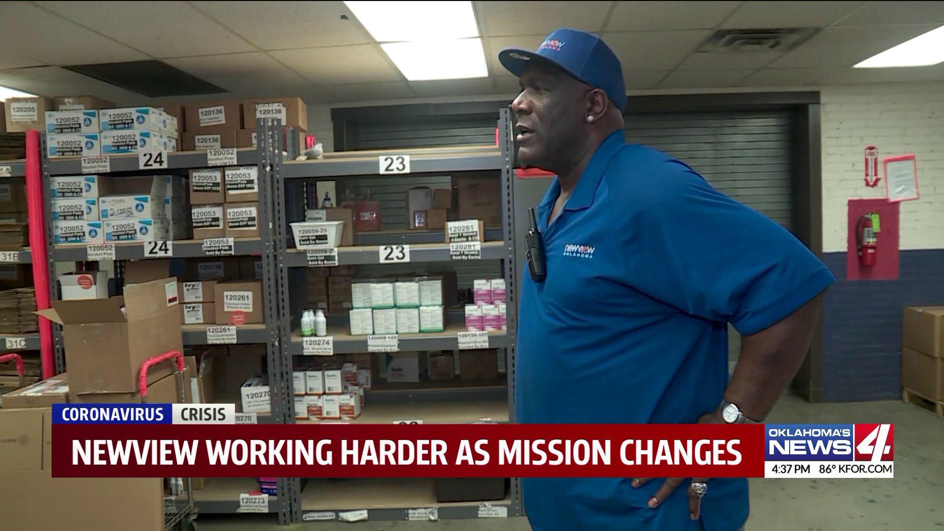 man looking at warehouse supplies