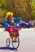 Clown on a bike.