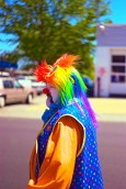 A profile of a clown passing the crowd.