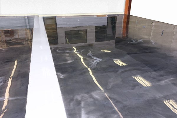 A dark gray and white metallic epoxy floor