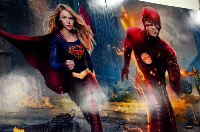 Supergirl and The Flash banner at the WB booth