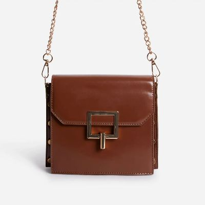 Frost Chain Strap Buckle Detail Mini Cross Body Bag In Nude Faux Leather
