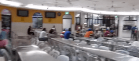 In Singapore Eat Langar on Tables and Chairs
