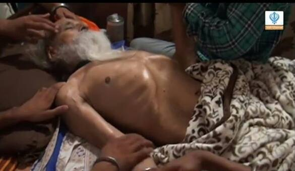 Dear People of the World, In this picture is an 83 year old American resident, Bapu Surat Singh. He has been on hunger strike for the past 183 days at his home village Hassanpur, Panjab, India. The reason for the hunger strike action is, he is requesting for the release of those Sikh political prisoners that have ALREADY completed their jail terms but are still languishing in Indian prisons. He is currently very weak, and does not have long to go. In this picture you can clearly see the deteriorating health of this elderly BRAVE and SELFLESS man. If you AGREE that those that have already completed their jail terms should be released as per the law, then we ask you to kindly share or like this post to help us raise awareness. Kind regards, SYP