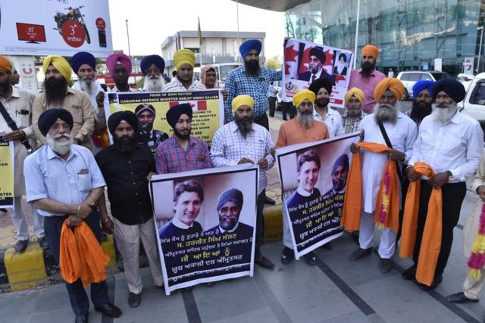 Members of the Shiromani Akali Dal (Amritsar) with welcome signs for Harjit Sajjan outside the Amritsar airport on Wednesday evening. Gurpreet Singh -HT