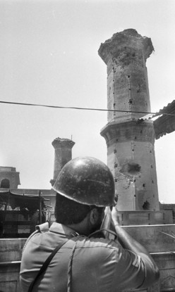 A security forces jawan takes aim at the towering 18th-century Ramgharia bunga during the Operation. Tribune File Photos - Karam Singh