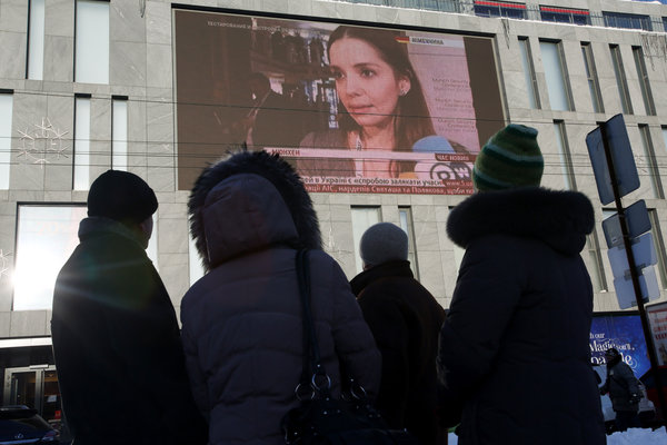 A screen on the Passage mall in Dnepropetrovsk, Ukraine, is used to defy the government. Joseph Sywenkyj for The New York Times