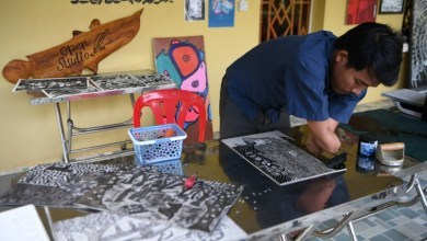 Photo of Cambodian double amputee artist fights stigma through art