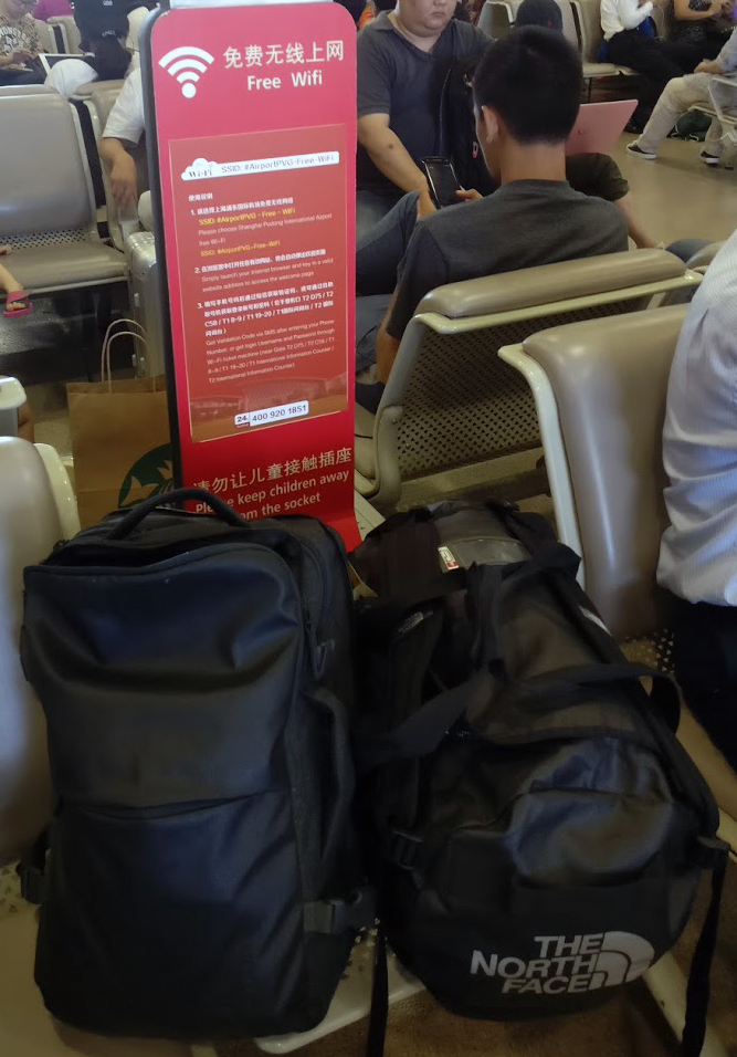 The bags I was carrying around and the instruction to get wifi at the Pudong International Airport.