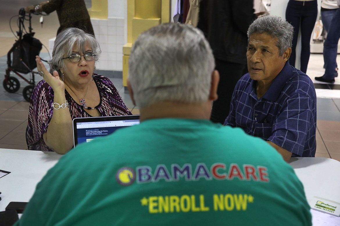 Couple being interviewed by an ACA representative