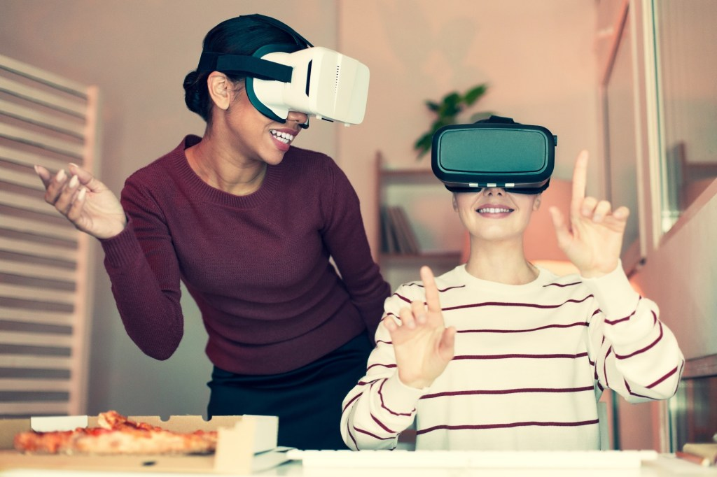 People eating with VR headset on