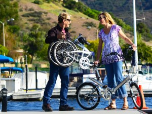 A couple enjoy a break after riding their folding bicycles
