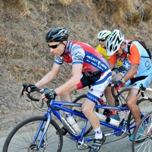 2 cyclists on Milano Tandem helping keep Disabled Athletes on the Road