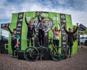 KHS pro mtb team rider Kailey Skelton standing on podium in first place at the first race of the DVO Gravity winter series.