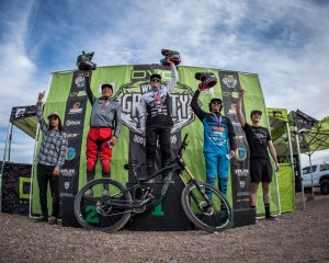 KHS pro mtb team riders on podium, Nik Nestoroff in first place and Steven Walton in third place at the first race of the DVO gravity winter series.