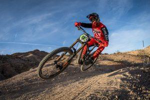 KHS pro mtb team rider Steven Walton riding down trail.