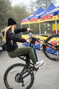KHS Pro MTB team rider Kailey Skelton riding around having fun and popping a Wheelie in the parking lot at the DH finals in Snowshoe W.V.