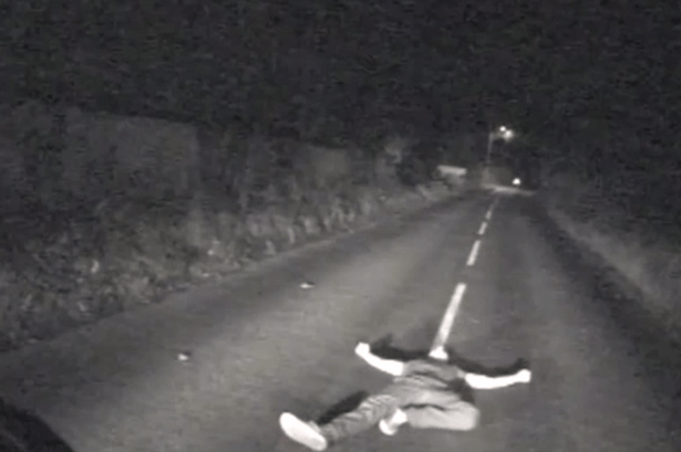 Bus-driver-avoids-man-lying-in-the-road