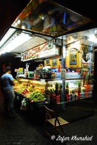 A wonderfully colorful fruit vendor in the Piazza di Spagna