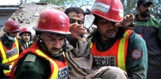 Rescue workers shifting injured to hospital