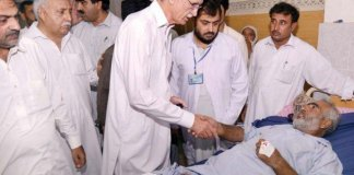 CM KP Pervez Khattak inquiring after the health of injured in Peshawar attack