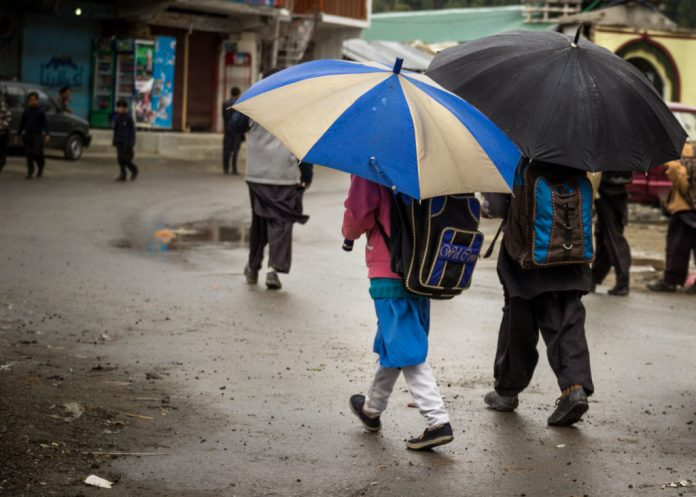 Parts of country in cold wave's grip after rain, snowfall