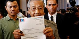 Malaysia's Najib raises doubt that Mahathir will succeed him