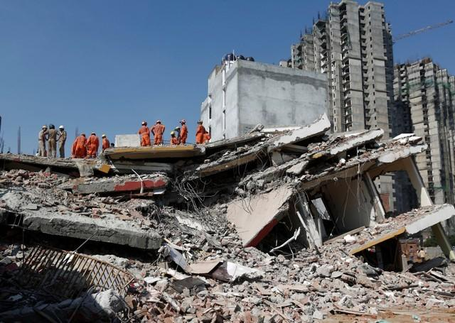 Building collapse in Delhi suburb kills at least two, more feared dead