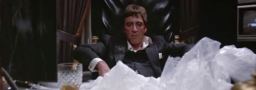 Tony Montana and a big ol pile of coke