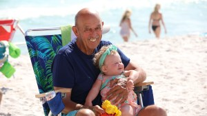 grandfather and great grand-daughter on the beach in Florida