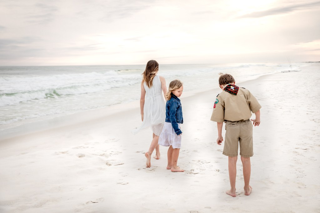 military kids walking on the beach in Fort Walton Beach, Florida
