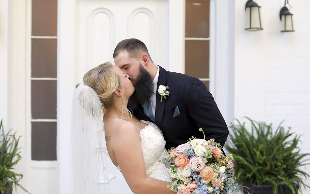 Bride and groom kiss at Cloverleaf Farms