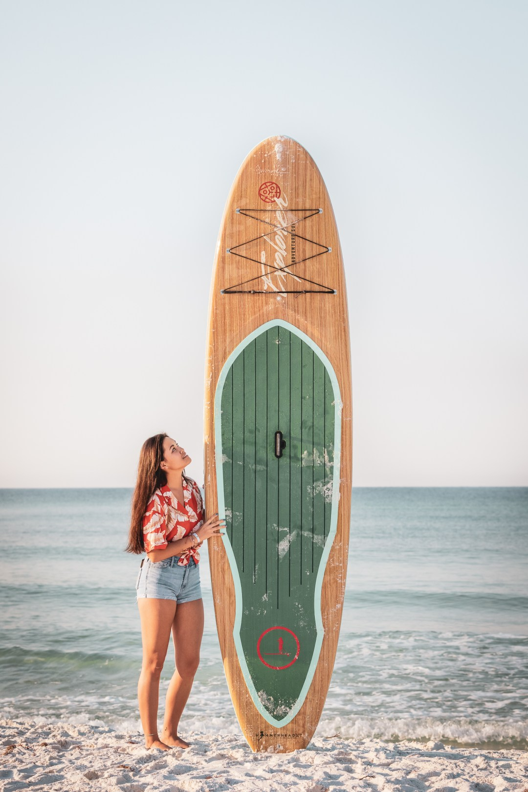 female model holding paddle board for branding photography shoot