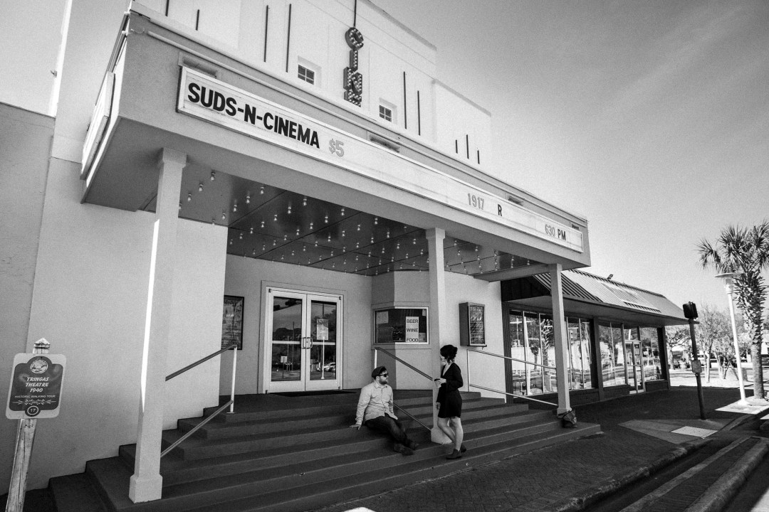 black and white photo of couple in front of Suds n Cinema theater in downtown Fort Walton Beach