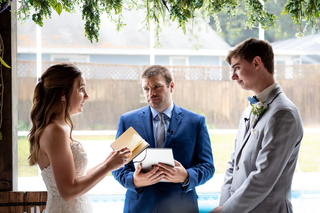 bride reading personal vows in COVID-19 wedding video