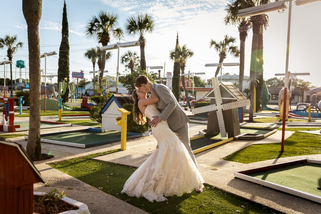 bride and groom in wedding attire at Goofy Golf in Fort Walton Beach