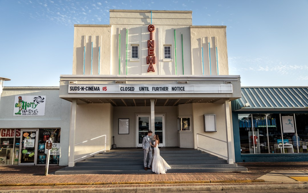 bride and groom portrait in front of cinema plaza in downtown Fort Walton Beach