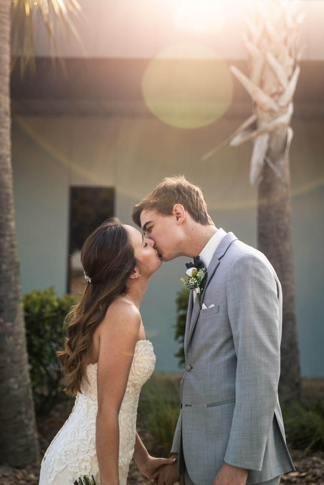 bride and groom kiss in front of Beachside Community Church in Fort Walton Beach, Florida