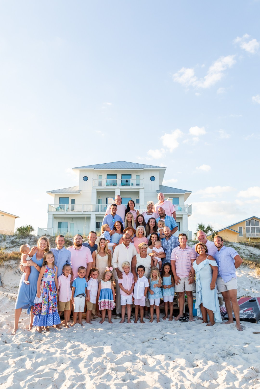 Large group family beach photos in front of best beach house