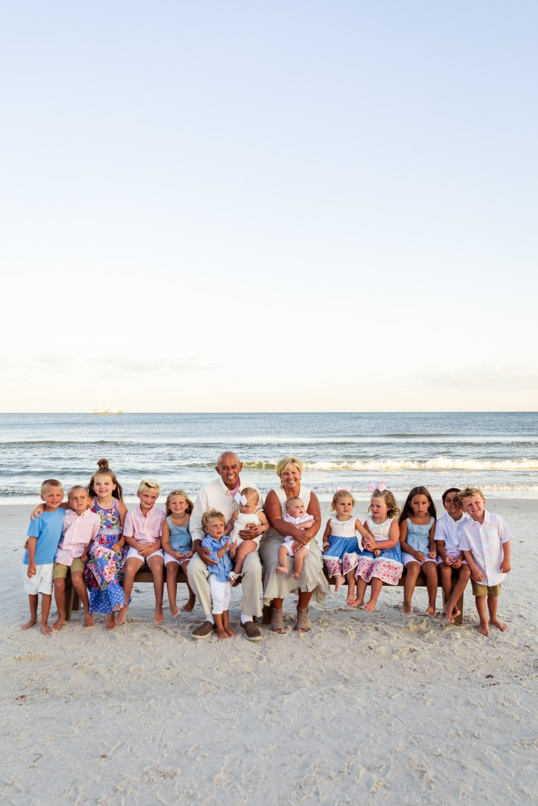 photo of great grandparents with great grand-babies on the beach