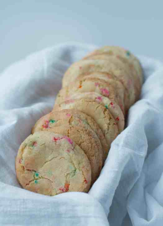 Fluffy Confetti Cookies | Easy Sprinkle Cookies - perfect for birthday parties and kids! Fluffy, soft, loaded with rainbow sprinkles and vanilla flavor | kickassbaker.com #cookies #rainbowsprinkles