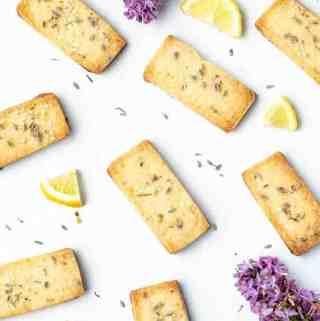 Lavender Lemon Shortbread Cookies overhead shot with flowers and lemon pieces strewn about