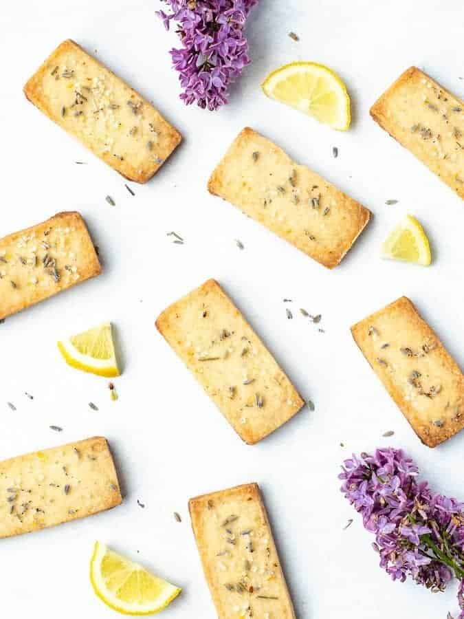 Lavender Lemon Shortbread Cookies overhead shot with flowers and lemon pieces strewn about