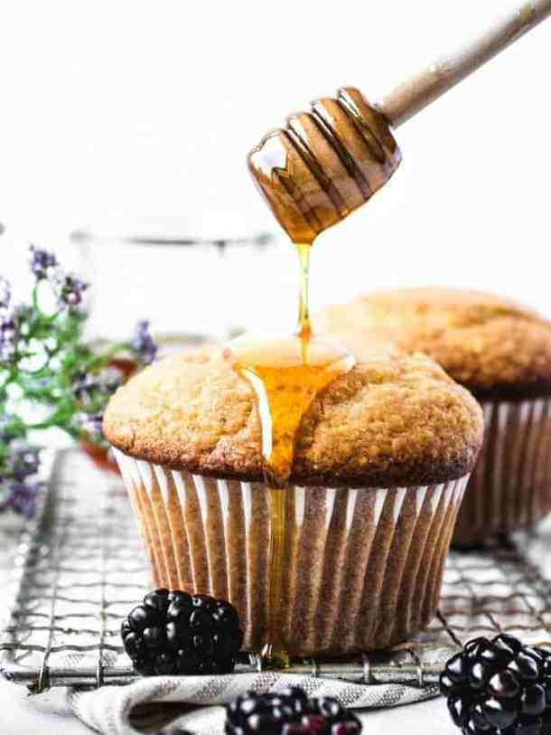 Corn Muffin being drizzled with honey