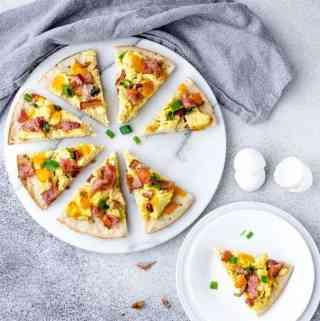 overhead image of cauliflower breakfast pizza sliced