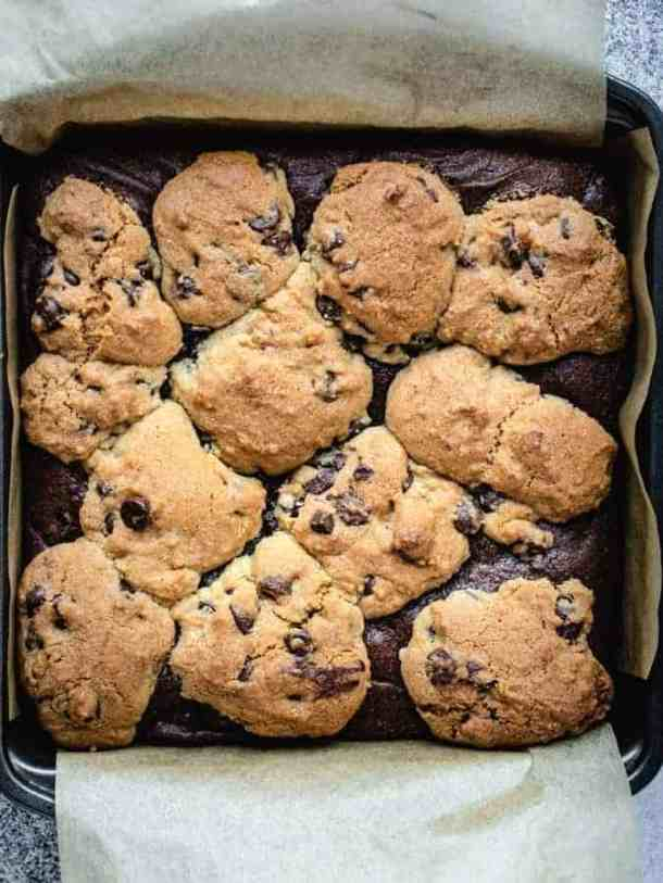 Overhead image of freshly baked brookies in a pan with parchment paper