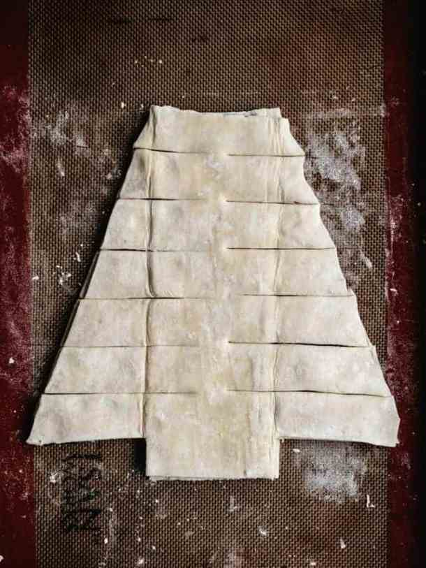 Cut out of limbs from puff pastry Christmas tree
