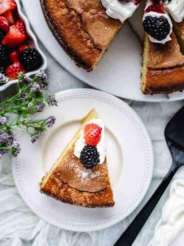 Overhead of slice of lemon olive oil cake on a plate