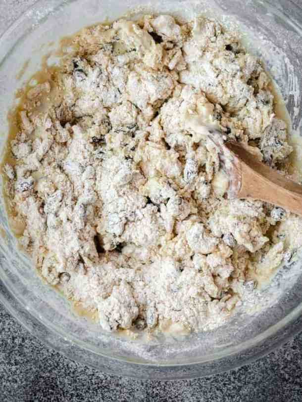 overhead of mixing Irish Soda Bread dough with a wooden spoon