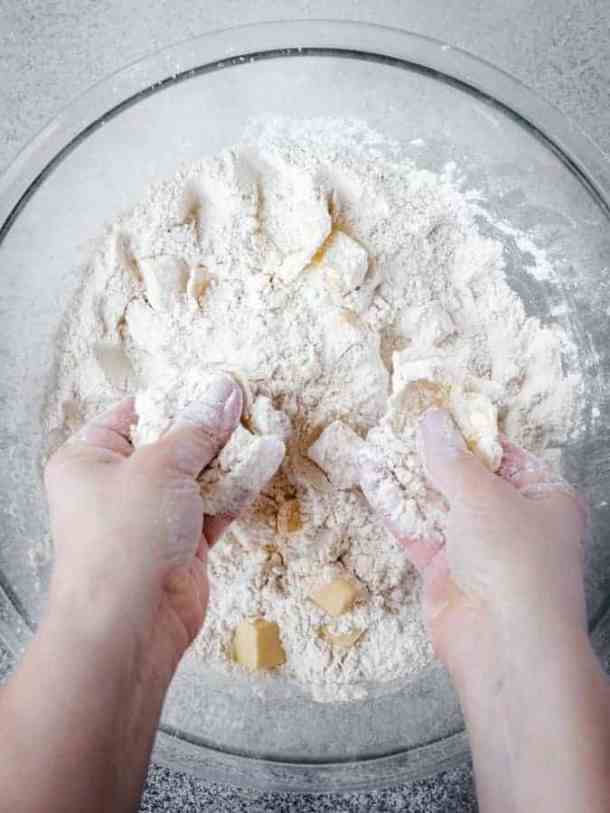 working butter into bread dough with fingers